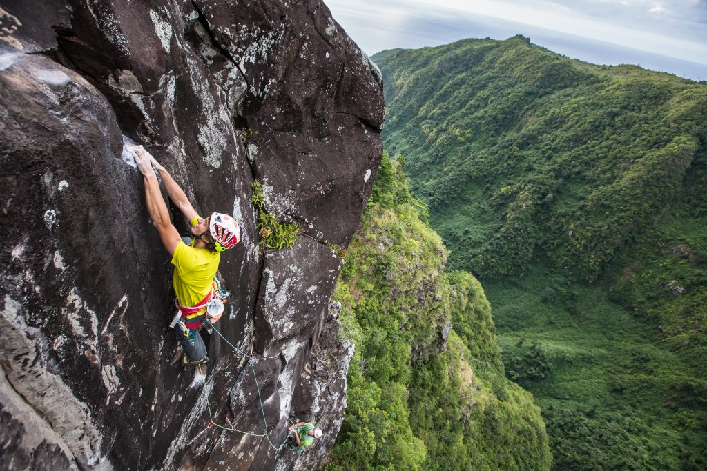 Jacopo Larcher climbs a new route in trad style on Ile de la Reunion, France.
